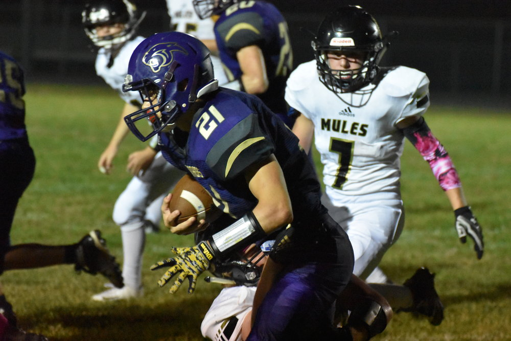 RICHEY HUFFMAN/Special to the Citizen  North Platte running back Joel Smyser (21) is tackled by a Lathrop defender during a game on Friday, Oct. 5
