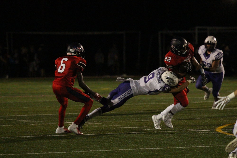 CODY THORN/Citizen photo  Park Hill South's Payton Murray (9) brings down Truman running back Andrew Owens during a Suburban Conference Red Division game on Friday, Oct. 6 at Truman High School. The Panthers snapped a 3-game losing skid with a 46-13 victory.