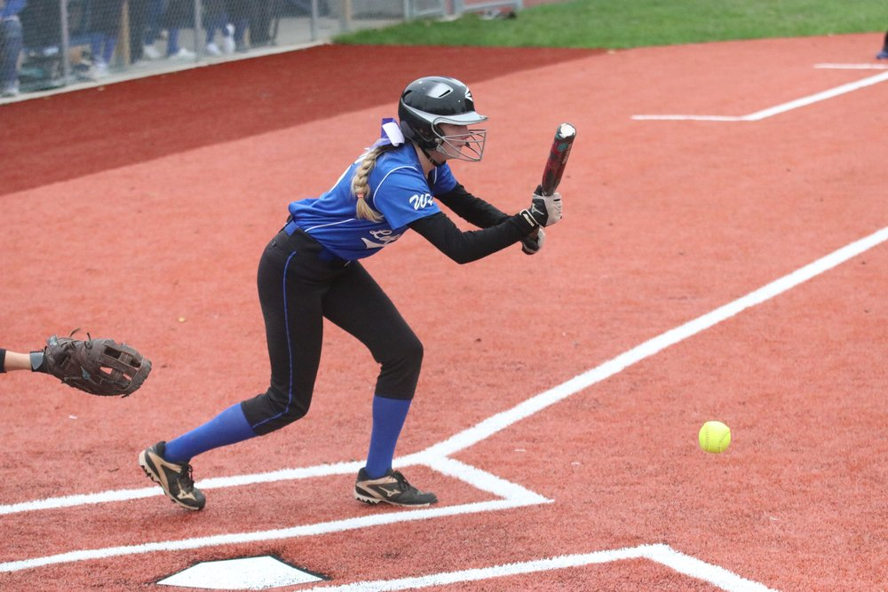 BRETT ADKISON/Clinton County Leader West Platte's Melanie Waters lays down a bunt attempt against East Buchanan on Wednesday, Oct. 10 in the first round of the Class 2 District 15 tournament held at Benner Park in Weston, Mo.