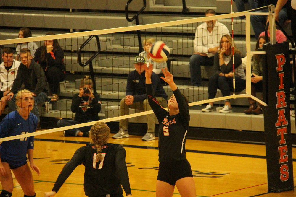 CODY THORN/Citizen photo Platte County's Ashley Bell sets the ball during a match against Grain Valley on Thursday, Oct. 11 at Platte County High School. The Pirates won in two sets in the Suburban Conference Blue Division game.