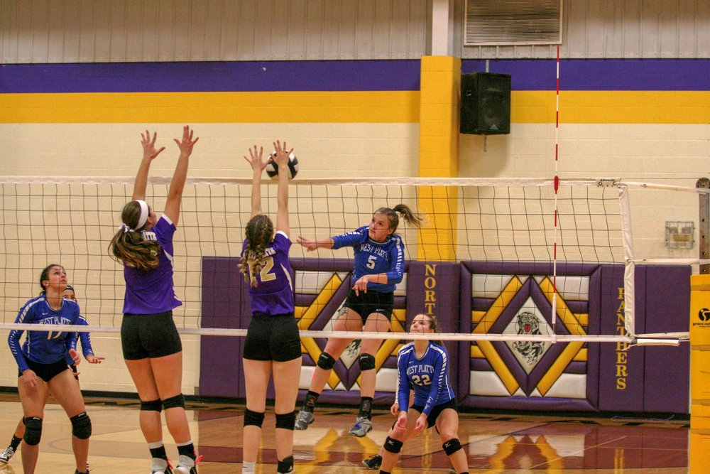 West Platte's Daire Stelljes, right, spikes the ball, while North Platte's Kelsey Reynolds goes up for the block during a KCI Conference game on Tuesday, Oct. 16 in Dearborn, Mo. West Platte won 2-0 and claimed the league title.