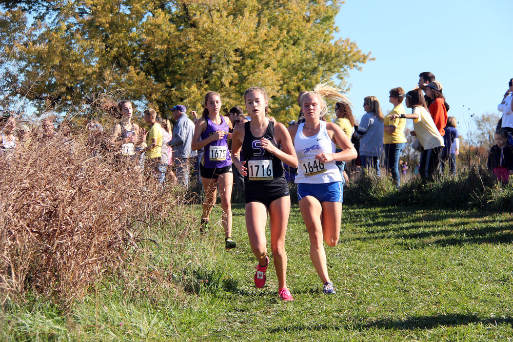 Park Hill South sophomore Skyelar Nelson, left, placed 15th overall in the race and will advance to state for the second straight year.