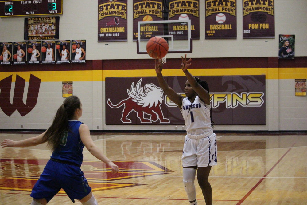 CODY THORN/Citizen editor  Park Hill South's DeQuaria Guillory, right, shoots a 3-pointer while being guarded by Blue Springs South's Hannah Smith during a semifinal game in the Winnetonka Tournament on Thursday, Nov. 29 in Kansas City, Mo.