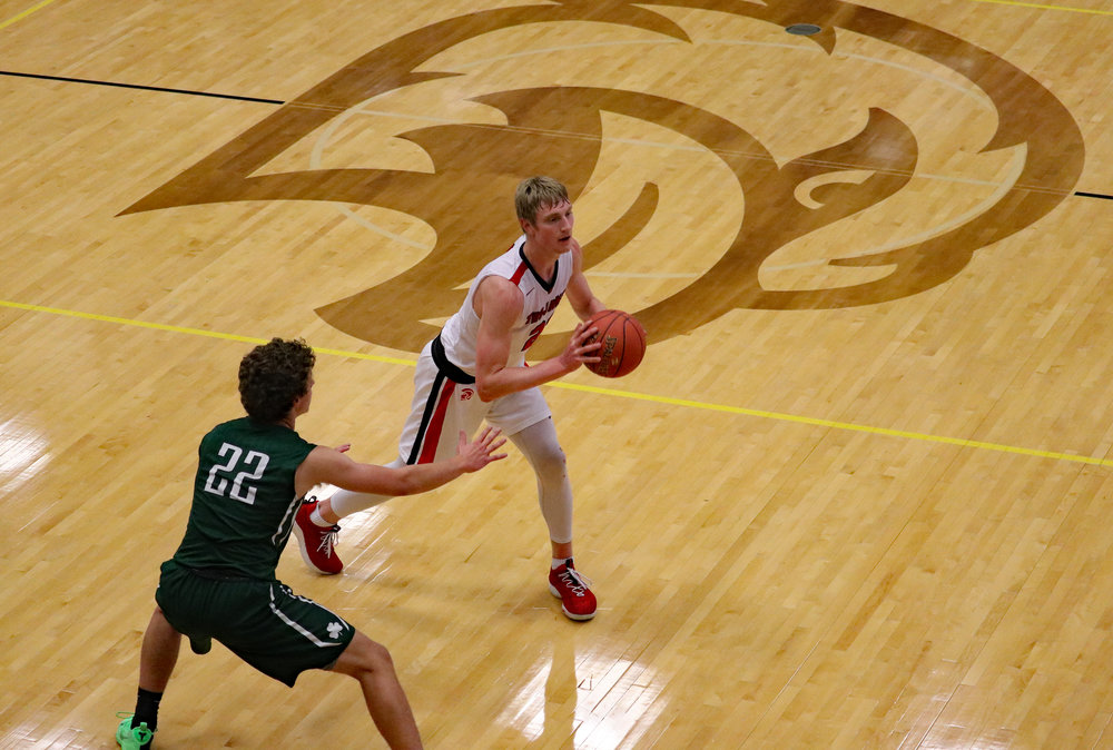 THOM HANRAHAN/Liberty Courier-Tribune  Park Hill's Nic Zeil, right, looks to pass to a teammate while guarded by St. Joseph Lafayette's Tyson Koch in the opening round game of the Liberty North Tournament on Thursday, Dec. 6.