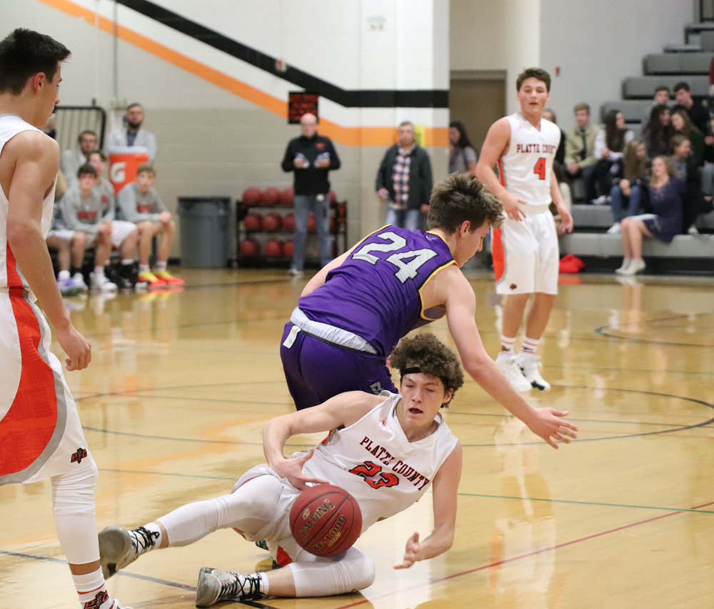 CODY THORN/Citizen photo  Platte County's Dylan Minshall, bottom, battles for a loose ball with Belton's Gavin Russell during a game on Friday, Dec. 7 at Platte County High School. The visiting Belton Pirates picked up a 58-55 victory.
