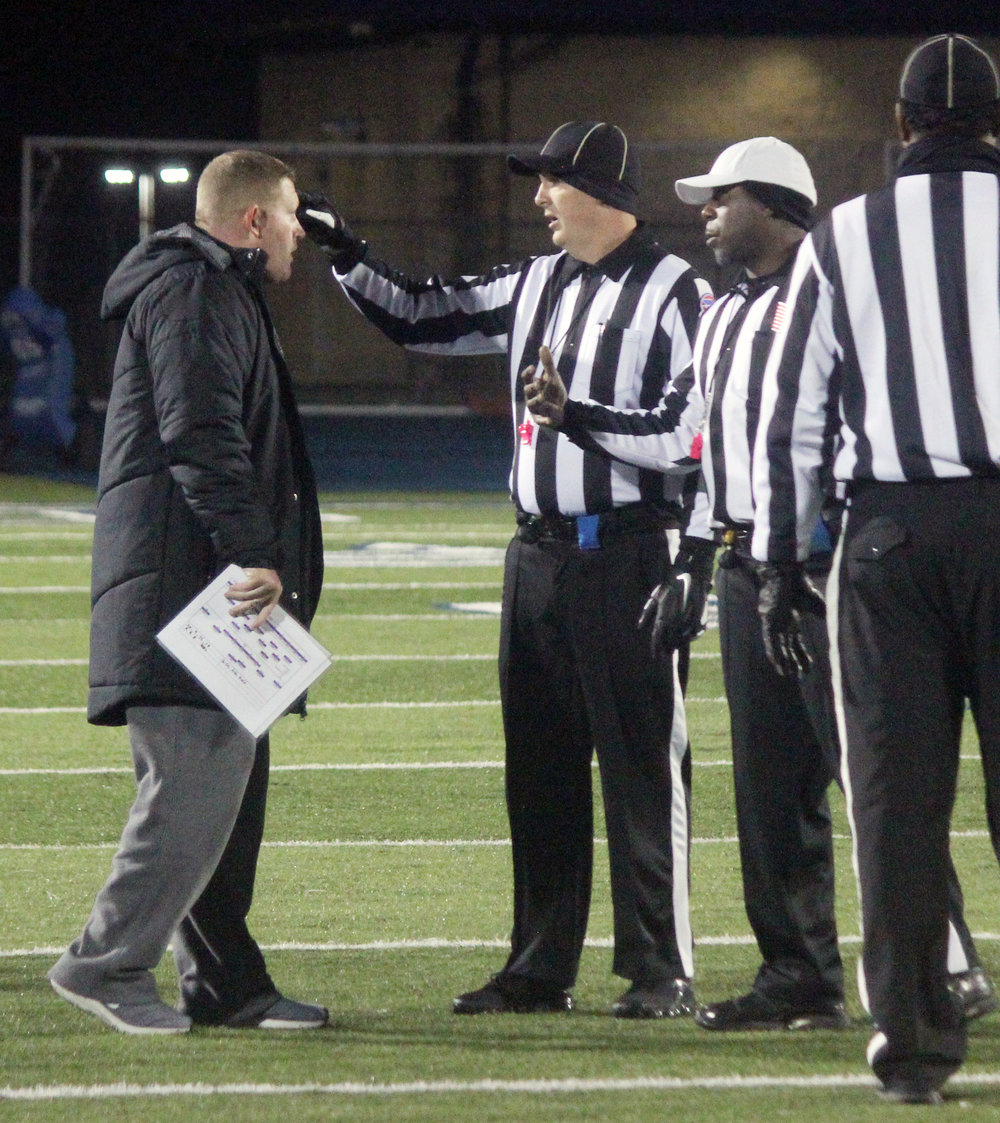 Citizen file photo  Park Hill South coach Mike Sharp, left, talks with officials during a game at Blue Springs South this past season.