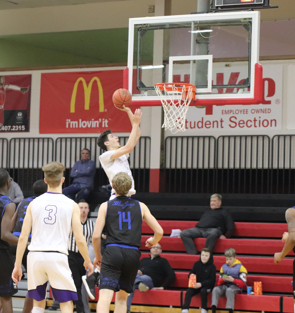 CODY THORN/Citizen photo  Park Hill South's Dylan Brougham goes up for a layup against Raytown on Friday, Dec. 28 at the William Jewell High School Holiday Classic in Liberty, Mo. Brougham had 12 points for the Panthers in a 69-53 victory.
