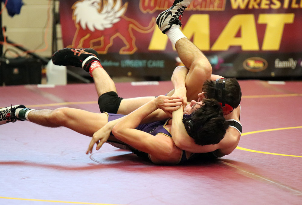CODY THORN/Citizen photo  Park Hill's Tyson Moore pins Eureka's Michael Hotop in a 152-pound match on Friday, Jan. 18 in the Winnetonka Tournament in Kansas City.