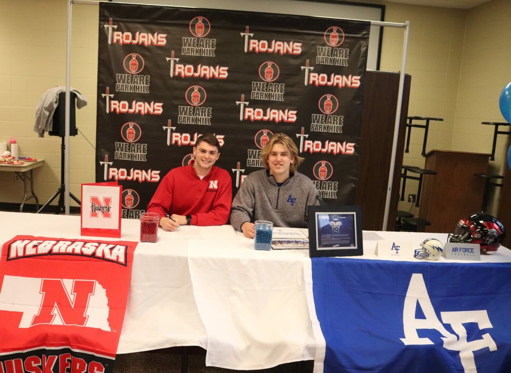 CODY THORN/Citizen photo  Park Hill's Kolby Heinerikson, left, signed to run for the Nebraska track and field team, while Air Force's football team landed defensive end Ethan Smith.