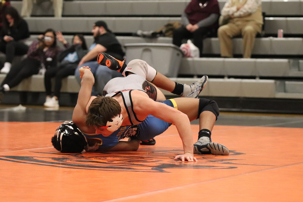 RILEY CRAWFORD/Special to the Citizen  Platte County's Nick Maddux takes down Grandview's Delaney Kibble and pins him during a match on Tuesday, Jan. 15 at Platte County High School.