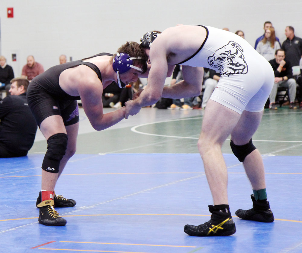 JASON LAWRENCE/Special to the Citizen  Park Hill South junior Cameron Gillespie, left, won a 10-3 decision in the 182-pound semifinals against Springfield Central junior Gabriel Fletchall on Saturday, Jan. 26 at the Lydia's Lights/Blue Springs South Tournament.