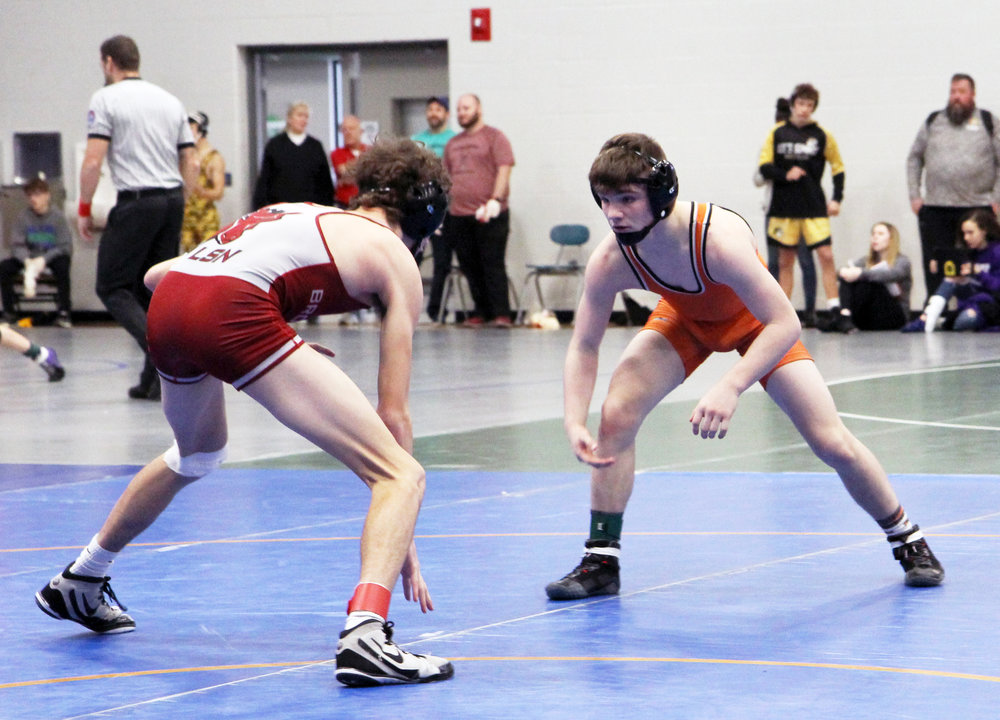 JASON LAWRENCE/Special to the Citizen  Platte County freshman Eli Rocha, right, won via technical fall, 18-3, against Lee's Summit North sophomore Cody Steinbrugge in the 120-pound semifinals at the Lydia's Lights/Blue Springs South tourney.