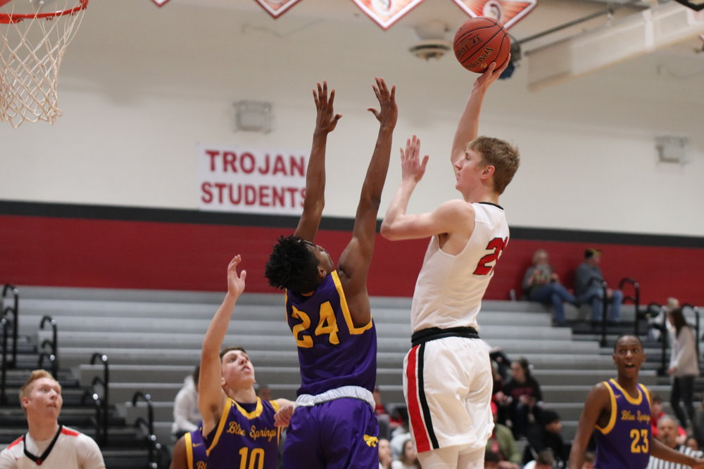 CODY THORN/Citizen photo  Park Hill's Nic Zeil, right, shoots a jumper over the outstretched arm of Blue Springs defender Najee Williams during a Suburban Conference Gold Division game on Thursday, Jan. 24 at Park Hill.