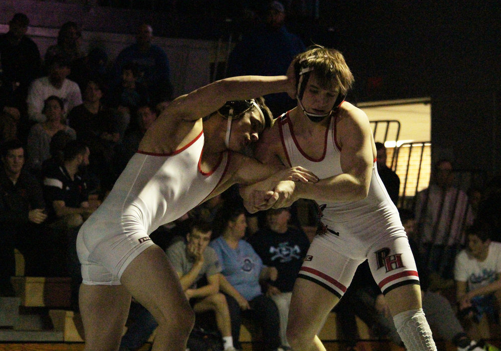 Park Hill's Grayton DiBlasi, right, battles Fort Osage's AJ Sanchez during a third-place match in the Class 4 District 4 tournament on Saturday, Feb. 9 at Oak Park High School. DiBlasi won the match and is a first-time state qualifier, the fourth of four DiBlasi boys to do so at Park Hill.