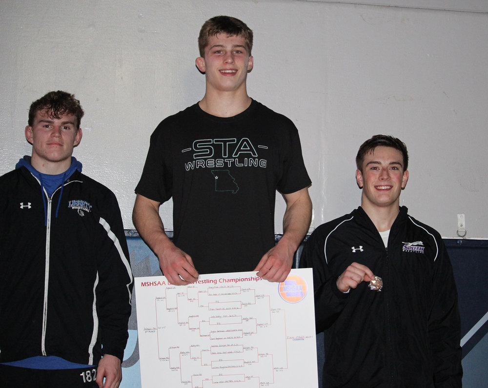 CODY THORN/Citizen photo  Park Hill South's Cameron Gillespie, far right, took third place in the 182-pound weight class in the Class 4 District 4 tournament on Saturday, Feb. 9 to earn a return trip to the state championship.