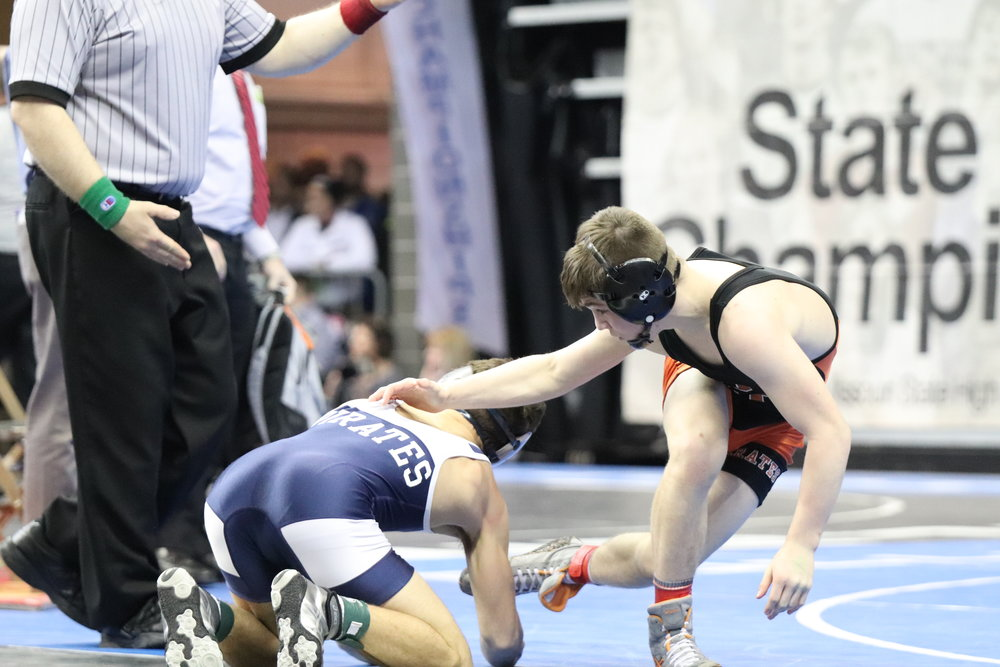 CODY THORN/Citizen photo Platte County's Eli Rocha, right, gets an escape against St. Charles' Ben Bohr in the third-place match in the 120-pound division in Class 3.