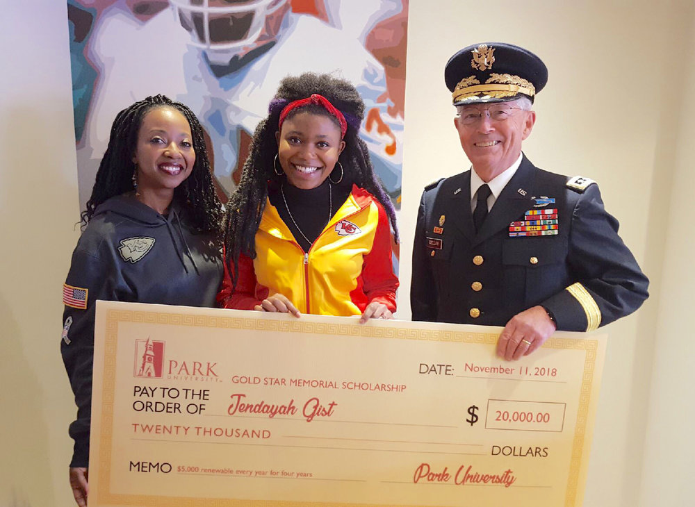Submitted photo Kearney resident Jendayah Gist, center, received a scholarship to attend Park University through Heroes United. She was presented the check during a ceremony at a Kansas City Chiefs game this past season. Next to her is her mother, Raheisha Freestone, left, and Lieutenant General Richard Keller of the U.S. Army, right.