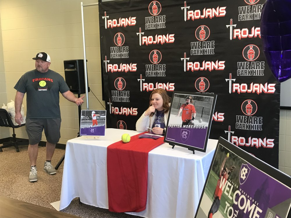 CODY THORN/Citizen photo  Park Hill softball coach Jackie Qualls, left, talks about pitcher Peyton Morehouse during her signing ceremony with the College of Holy Cross in Worchester, Mass.