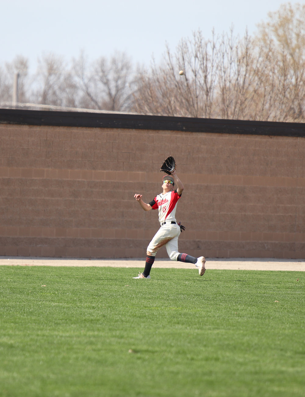 CODY THORN/Citizen photo  Park Hill's Max Pitts tracks down a fly ball during a game against Platte County on Saturday, April 6 at Park Hill High School. The Trojans won the game, 12-1.