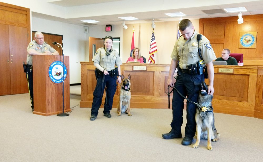 JEANETTE FAUBION/Citizen photo Sheriff Mark Owen introduced canine officers Ajax and his handler deputy Jessica Harrison and Aries and his handler deputy Matt King to the Platte County Commissioners at their Monday, April 15 meeting in Platte City. The new dogs reported for duty after six weeks of training out of state.