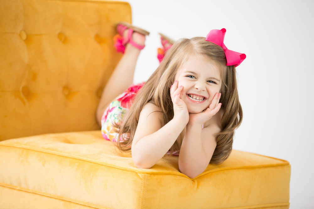 laughing little girl studio pictures hillary frost.jpg