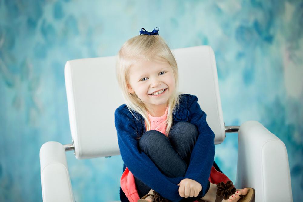 smiling little girl studio portraits hillary frost.jpg