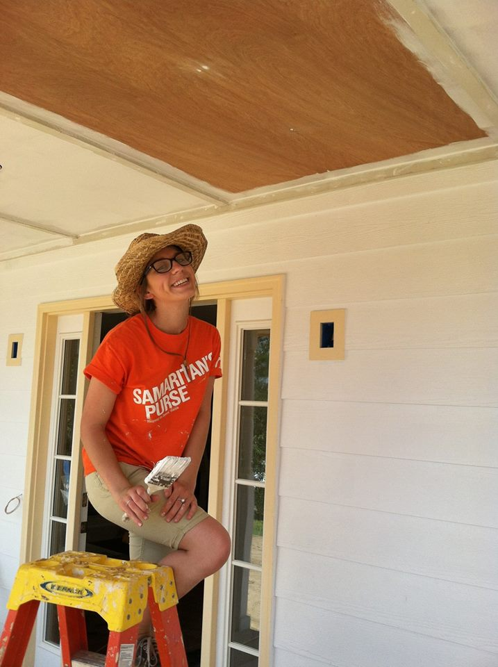 Katie painting the front porch ceiling