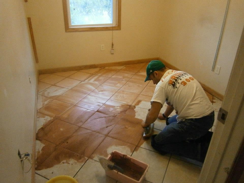 Don grouting the tile.