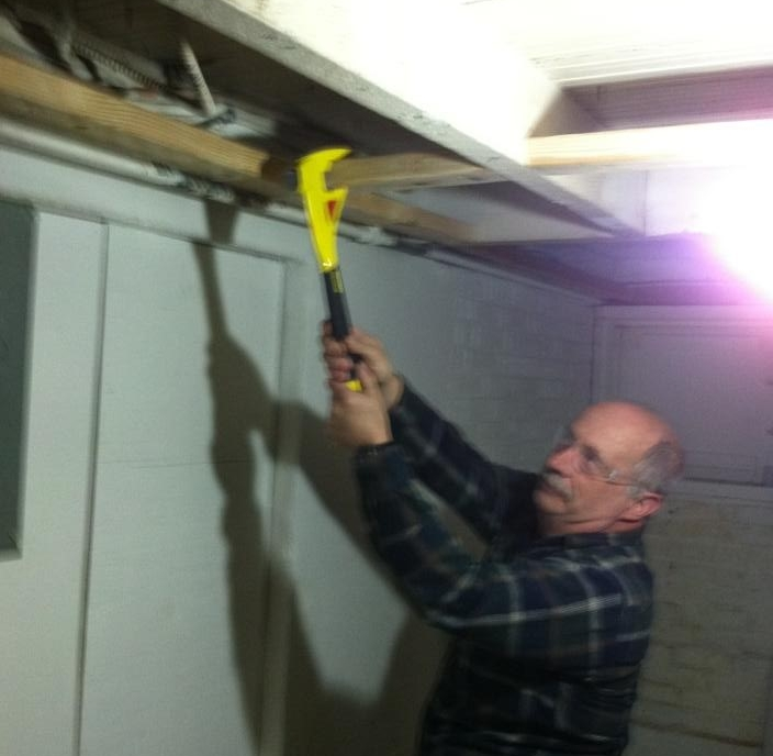 Jim removes some woodwork in preparation for installing the ceiling.
