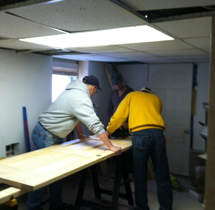 Gene and Terry work on one of the seven doors we replaced for this home owner.