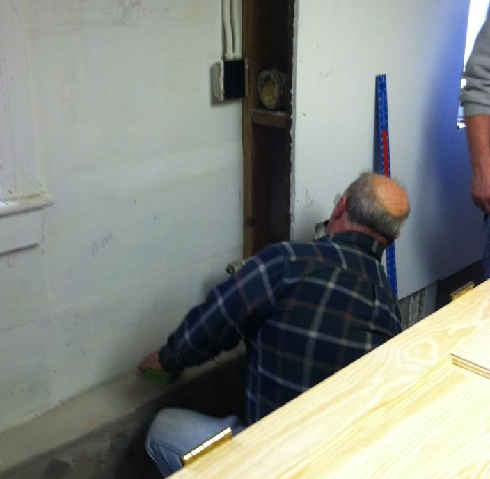 Jim prepares for the installation of the new kitchen.