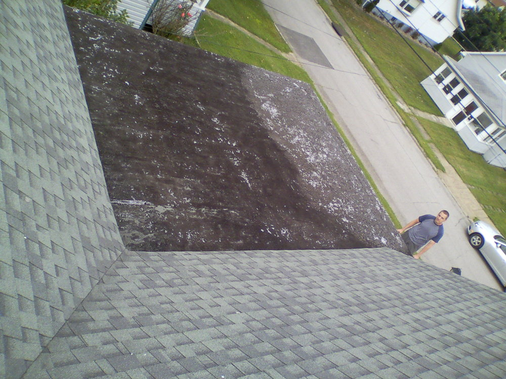 This picture shows the existing roof material that was causing the leak.