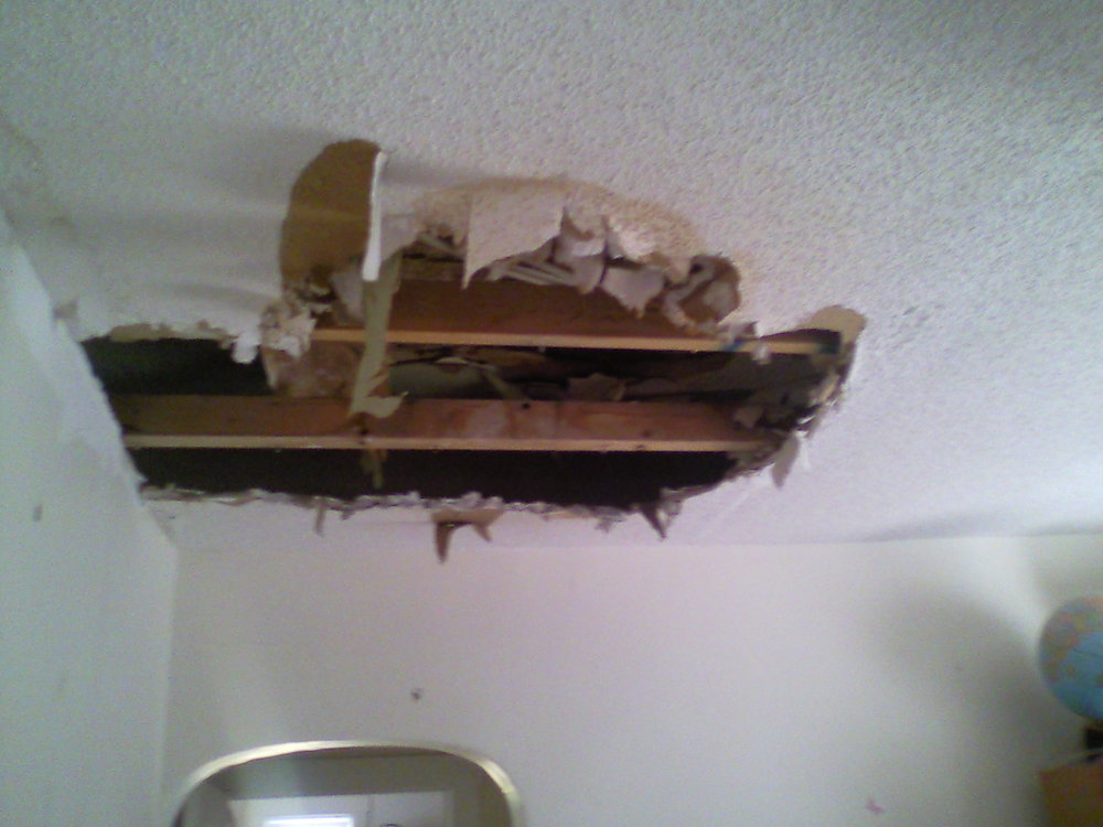 This shows the damage caused by water line break in bathroom above.