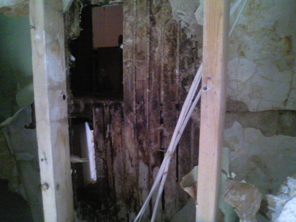 This shows the damage to bathroom floor from water pipe break.