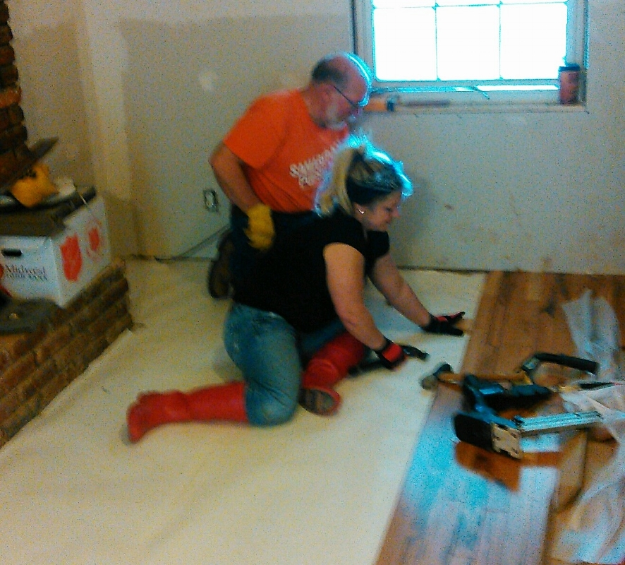 Ben and Christina install hardwood flooring.