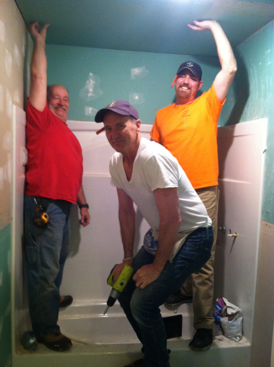Aaron, Terry and Jim install green board in the bathroom. Walls and ceiling were installed.