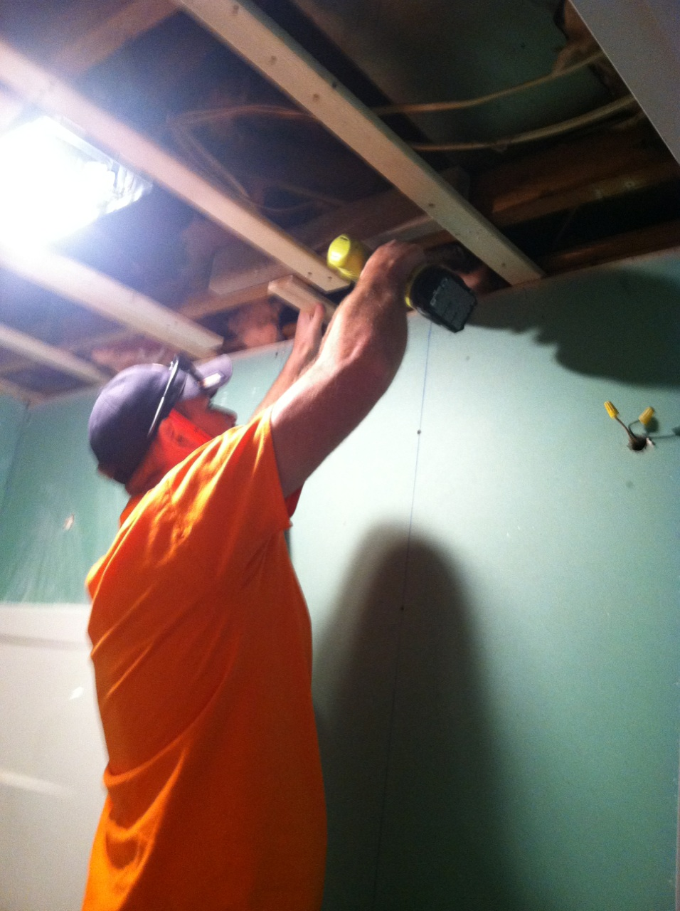 Aaron preps the ceiling for green board.