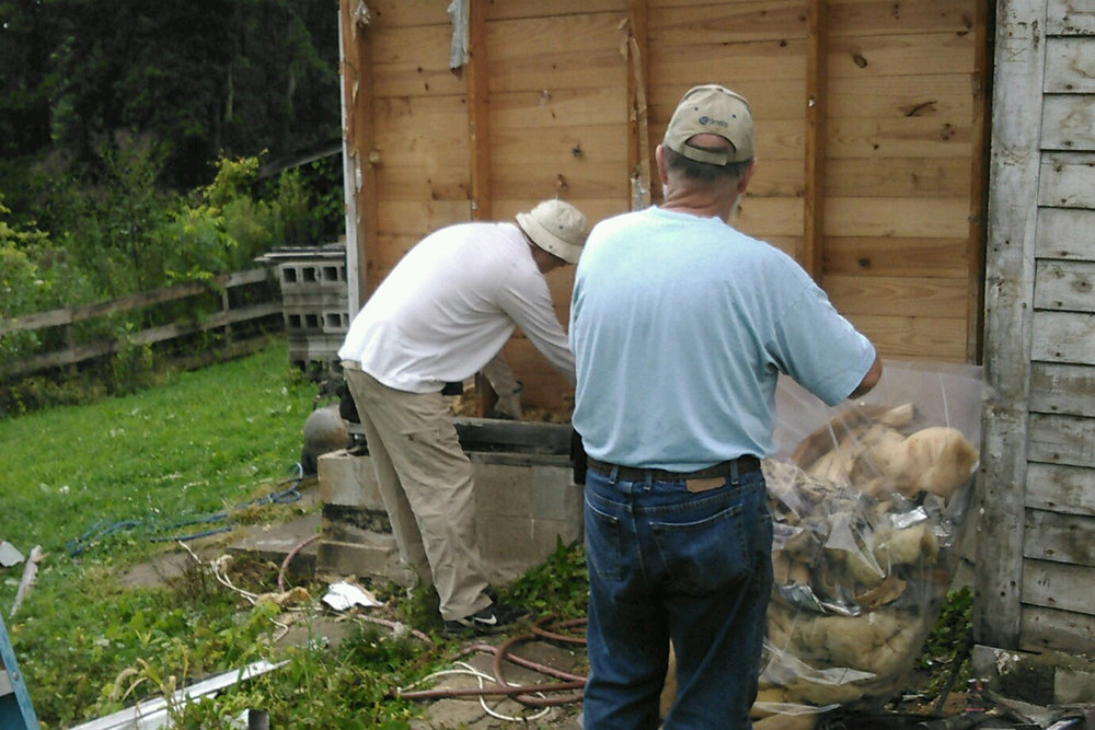 Ron and Ben remove old wet siding.