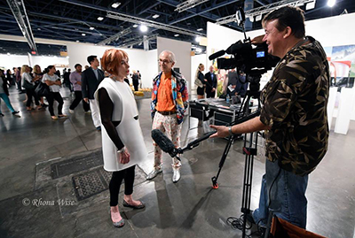 Attendees at Art Basel, left, being interviewed by Tony Winton in Miami Beach, Fla., December 2014. Photo: Rhona Wise