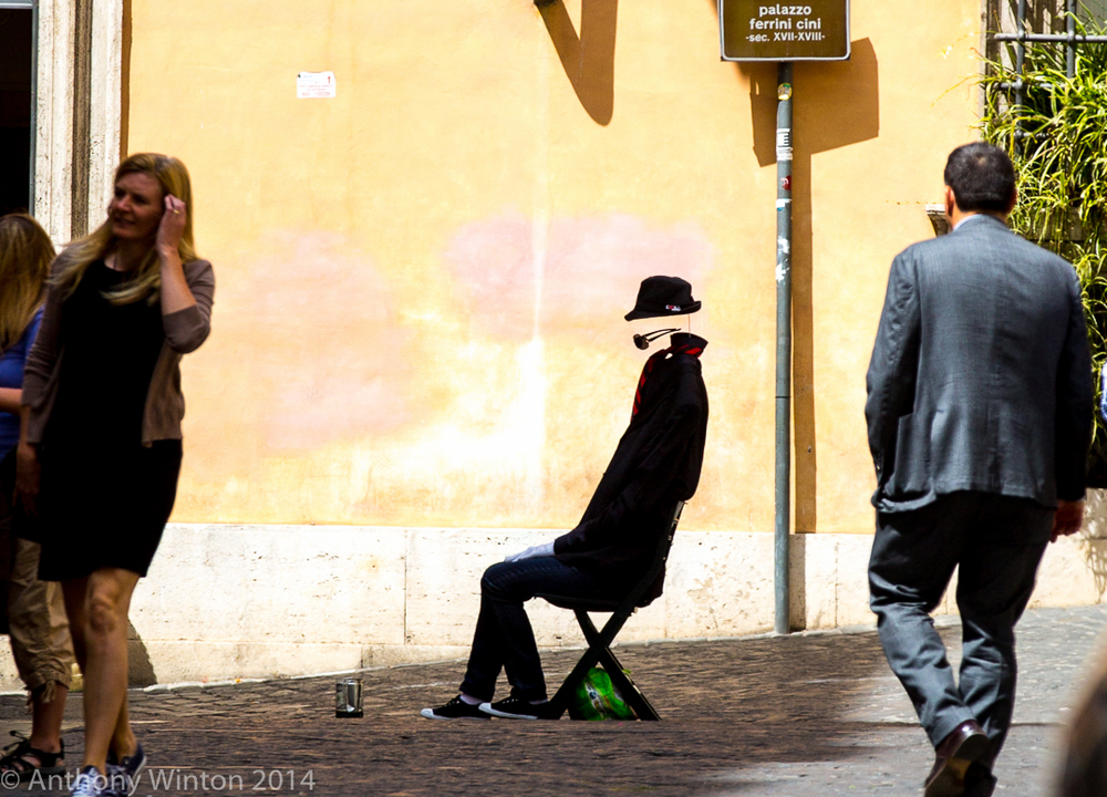 INVISIBLE MAN puppet used to solicit donations from passersby, Rome, 2014