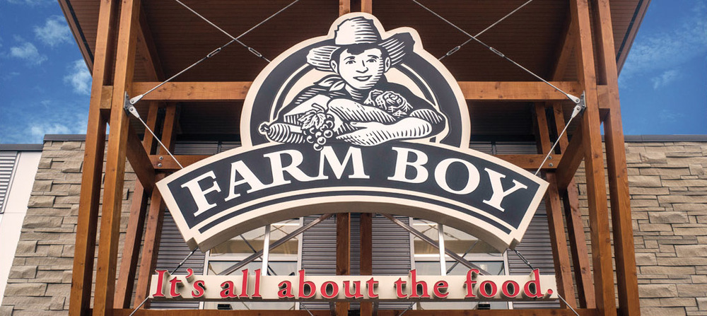 "Farm Boy - Our New Go-To Grocery Store in Durham. We found out about Farm Boy from a client last week and decided to check it out this past weekend. Located in Whitby at the corner of Taunton and Garden in the Taunton Gardens Plaza we walked in with an expectation that it was going to be your typical grocery store experience… nope we were wrong. We were greeted at the door by Lulu the Cow and a farm girl in oversized denim coveralls with pigtails saying hello to customers as they trickled through - fun for kids and funnier for adults. Lulu greets customers every Saturday from 10 am to noon. There are samples all throughout the store which is great if you skipped breakfast like us! Everything is fresh, locally sourced, healthy and overall an enjoyable shopping experience. Here's what will you find at Farm Boy: Abundant varieties of high quality fresh produce, including organic and local, when in season. Hundreds of organic, natural and gluten free products. Fresh prepared, Farm Boy Kitchen™ meals, made from scratch with wholesome ingredients and no preservatives. 50-foot fresh salad and hot bars. Hormone-free, fresh organic beef, pork and chicken. Canada AAA Beef from Alberta marbled and aged for tenderness and great flavour. Eco-friendly, sustainable fresh seafood. 300 local farmstead, artisan, international and Canadian award-winning cheeses. 150 fresh deli meats cut to order including turkey, beef and pork roasts, marinated overnight and slowly roasted without preservatives. 500 fresh Ontario dairy products like our organic milk delivered fresh throughout the week. Products made by local suppliers. Scoop your own fresh bulk items like nuts, grains, seeds and sweet treats. Hundreds of our own, high quality, Farm Boy products. Eating area with free WiFi (Source: www.farmboy.ca/about-us) The Farm Boy chain has been around for over 30 years. Starting in 1981 in Cornwall Ontario with a 300 sq. ft. store by Jean-Louis and Colette Bellemare. The latest Whitby store is an impressive 28,000 sq. ft. Talk about growth! Fun Facts: Farm Boy 2012 Inc., was selected as Canada's 50 Best Managed Companies They have 18 stores in Ontario with one soon opening in Kitchener in 2016 They were selected by the Alcohol and Gaming Commission to be one of the grocery stores in Ontario that sell Beer! CEO Jeff York talks about the addition ""Our customers have come to enjoy the experience of finding high quality, artisanal products made fresh in Ontario in our stores, so naturally we will apply this same approach with beer. Introducing unique, and specialty craft beer is a natural extension of our business and will compliment the shopping experience giving customers another great reason to shop in our stores."" (Source: www.farmboy.ca/farm-boy-to-offer-in-three-ontario-food-stores) Let's talk about the most important thing, PRICE. When people hear, healthy, locally sourced, organic they automatically think its $$$. Farm Boy is totally reasonable and affordable for families large and small. They sell all their milk, which is Organic by the way in recyclable glass bottles for $3.99 with a $1 deposit. We walked out with 5 loaded bags totally just under $85. Amazing.   If you are looking for a grocery store with products with ingredients that you can pronounce, produce that is fresh and locally grown then Farm Boy is the place for you! Their motto on their website reads; ""The best foods. The best shopping experience. Making life better. This is our vision."" Mission accomplished if we say so ourselves. Happy shopping! Tell Lulu that EastGTALiving sent ya! Store Info: www.farmboy.ca https://www.farmboy.ca/locations/whitby-taunton-gardens-coming-soon/"
