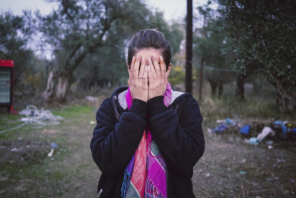 Merjan* standing outside Moria Camp, Lesvos, Greece. November 2016. Photo: Talitha Brauer