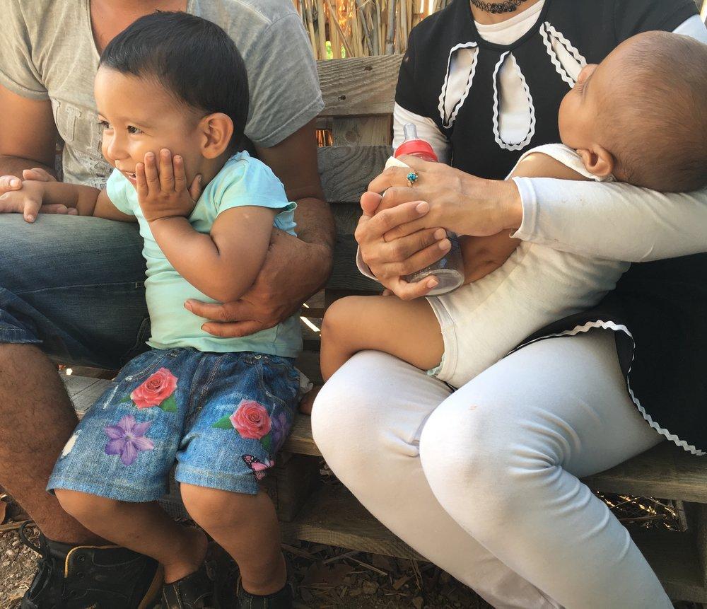 Aarash, Ezin, & family, Lesvos, Greece. Photo: Hannah Pruzinsky