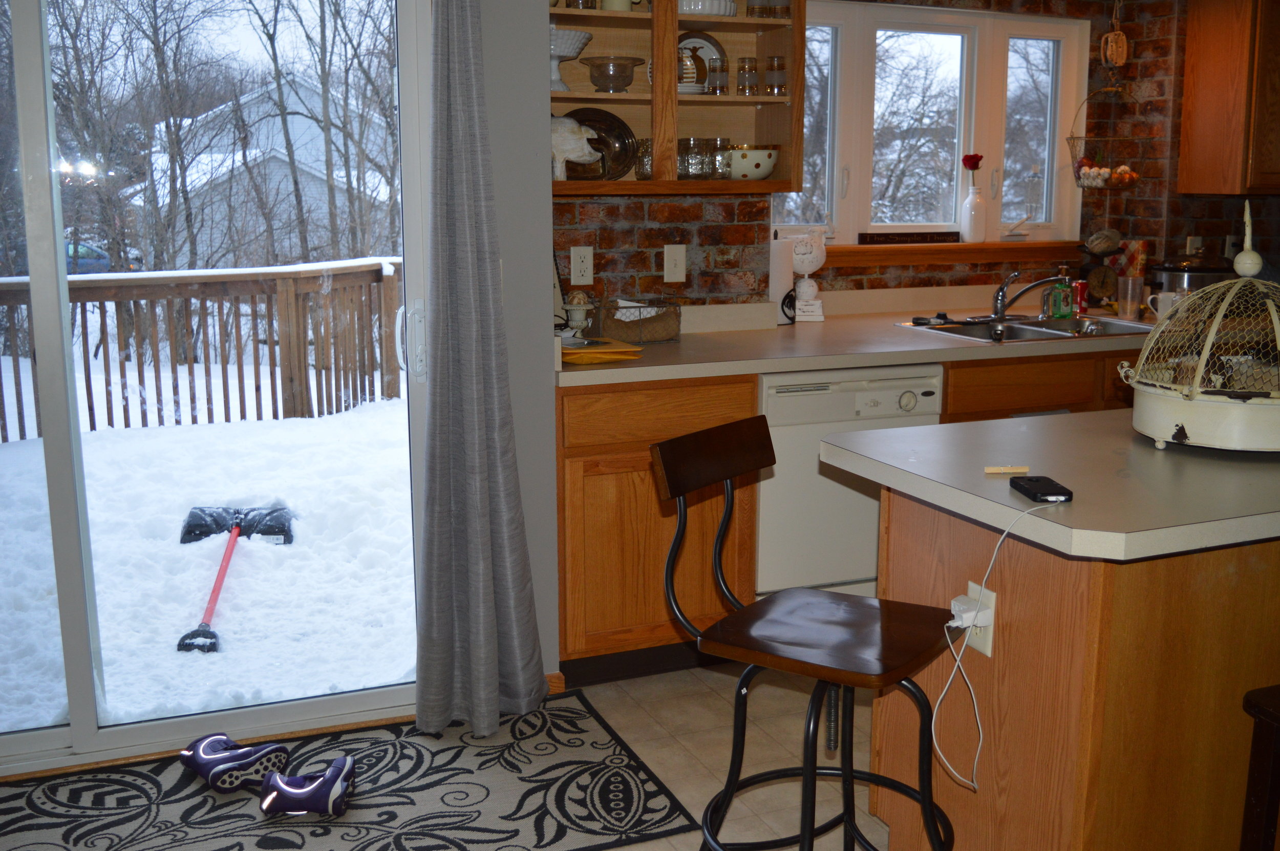 I wish I could enlarge this so you could see the finger prints on the sliding glass door.  Please notice the snow boots on the floor, the mail piled on the counter and someone's phone charging out of the designated charging station!