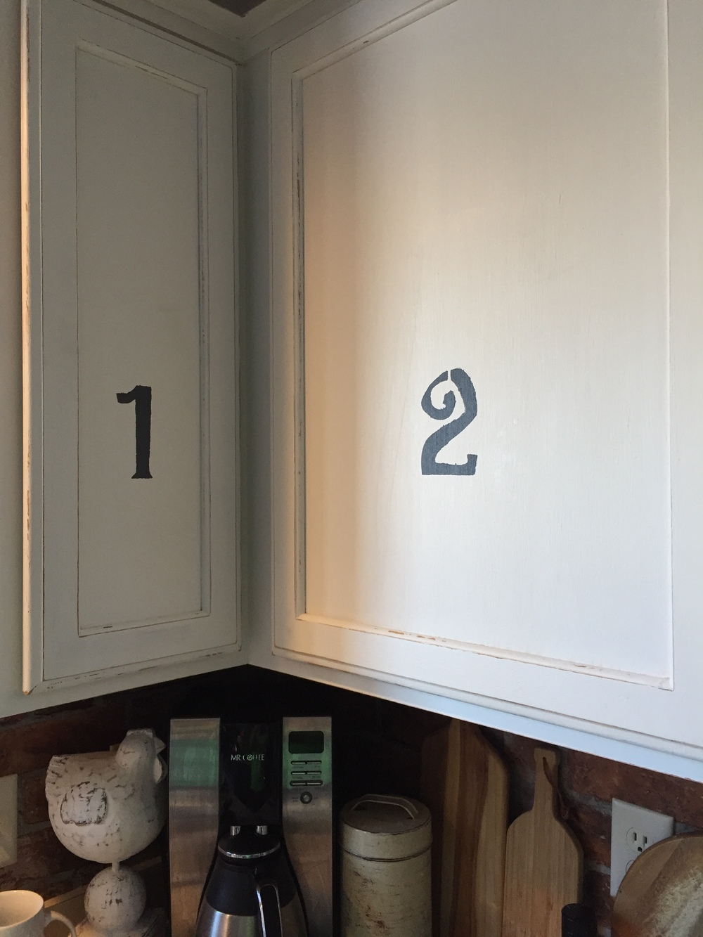 Stenciled numbers applied to cabinet door fronts