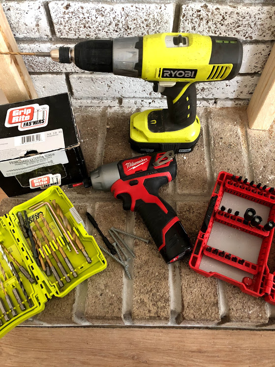 I used a combination of my Ryobi drill to pre-drill the holes in the stone and wood along with my impact driver to drive the screws in through the wood into the bricks.