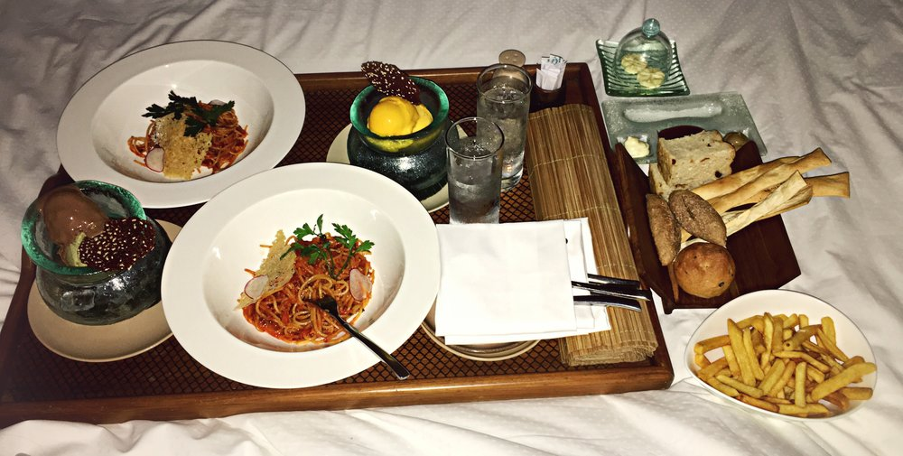 Late night room service anyone?  If you guys follow me on Instagram and watched all of my Bali travel stories, I wasn't lying when I said I was on an all carb diet...   After having terrible Bali belly for several long days, I finally got my appetite back and decided to order off the kids menu because I was having issues finishing my adult portions haha. Needless to say, the speghetti was bomb.  It was really nice to have some western food after eating so much traditional Balinese food!  Spaghetti, bread basket, french fries and ice cream. (time to hit the gym)