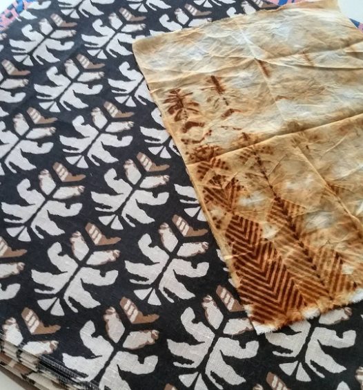 Finished design Wild Palms against it's original rust dyed pattern.