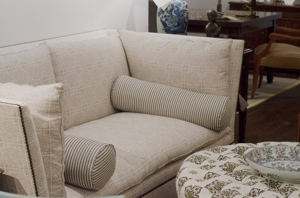 IRISH TILE ON SOFA, SMALL STRIPE BOLSTERS AND DIAMOND DAISY OTTOMAN