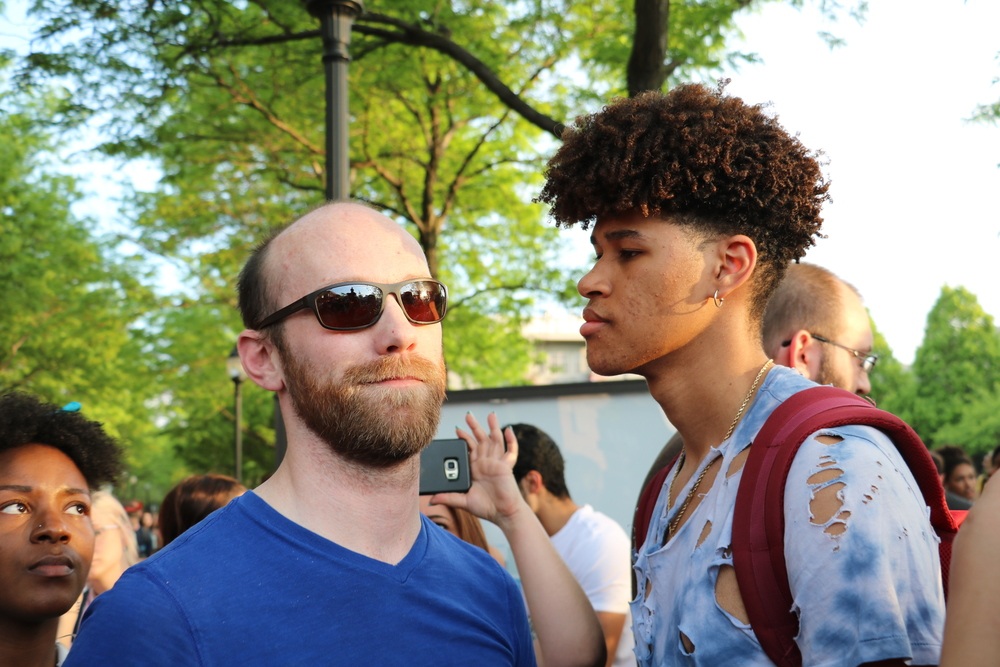 A protestor stands face to face with a visitor on DePaul's campus to hear Yiannopoulos speak. Photo courtesy of  Chloe Burch .